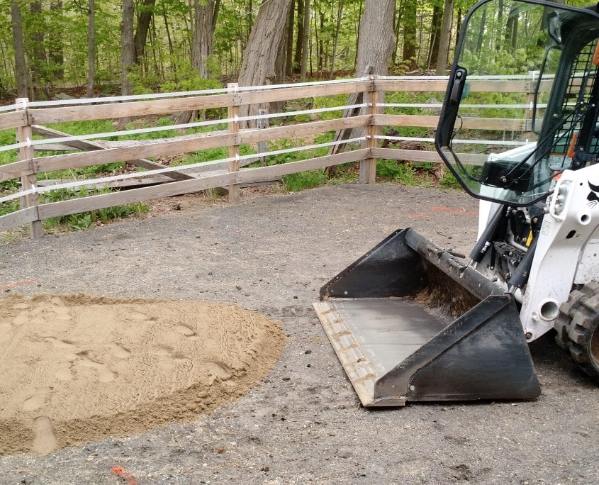 Bobcat excavating a horse track in dover nh