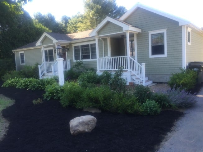 Additional photo of yard installation and mulching in Dover NH taken from end of the driveway.