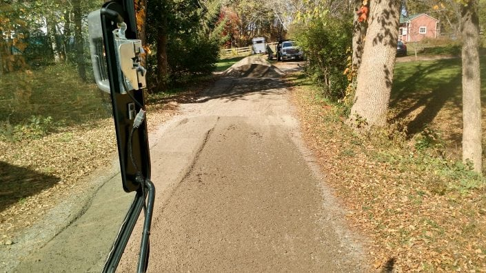 Here is driveway grading in Rochester after it was performed with excavation.