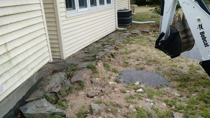 Here is where we installed a stone patio using the excavator in Dover NH. This is a before image!